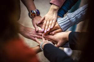group of people connecting hands